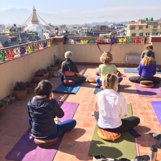 Yogis up on a Boudha rooftop